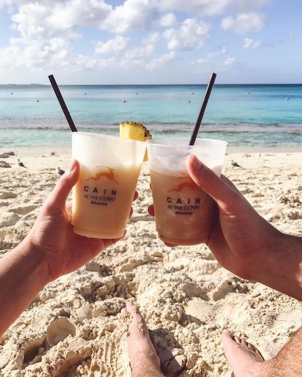 Cheers! Pina Coladas on the Beach at The Cove Atlantis, Paradise Island, Bahamas.
