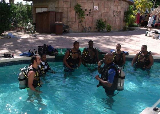 A scuba diving lesson takes place in Nassau Paradise Island, Bahamas